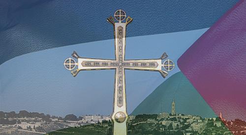 الصليب وفي الخلفية علم فلسطين