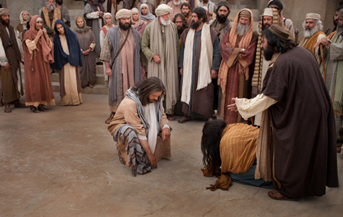 المسيح يكتب على الارض