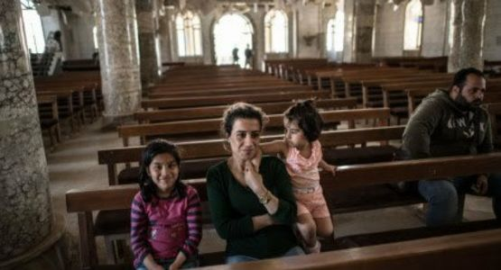 قائد مسيحي يحذر من أن الاضطهاد قد يكون اسوأ إذا انسحب بايدن من العراق