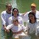 كنيسة بيت يسوع الملك تقوم بخدمة معمودية في اليردنيت